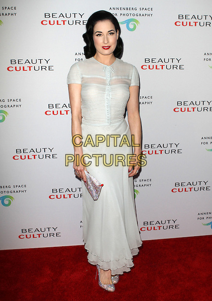 DITA VON TEESE .at The opening of Beauty Culture - a photographic exploration of how feminine beauty is defined, challenged and revered in modern society held at Annenberg Space for Photography in Century City, California, USA,.May 19th 11..full length white long maxi dress  silver shoes clutch bag .CAP/ADM/KB.©Kevan Brooks/AdMedia/Capital Pictures.