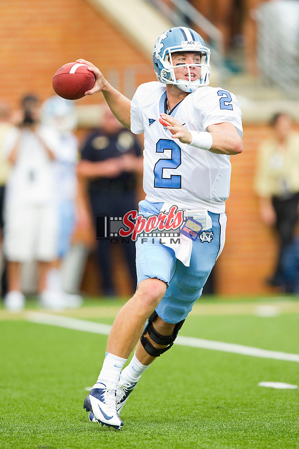 Bryn Renner (2) of the North Carolina Tar Heels rolls out to his right looking to pass the ball during the game against the Wake Forest Demon Deacons at BB&T Field on September 8, 2012 in Winston-Salem, North Carolina.  The Demon Deacons defeated the Tar Heels 28-27.  (Brian Westerholt/Sports On Film)