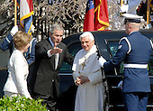 Washington, DC - April 15, 2008 -- United States President George W. Bush, center points Pope Benedict XVI, right, towards the podium as he arrives at the White House in Washington, D.C. on Wednesday, April 16, 2008. First lady Laura Bush is at far left. .Credit: Ron Sachs / CNP.(RESTRICTION: NO New York or New Jersey Newspapers or newspapers within a 75 mile radius of New York City)