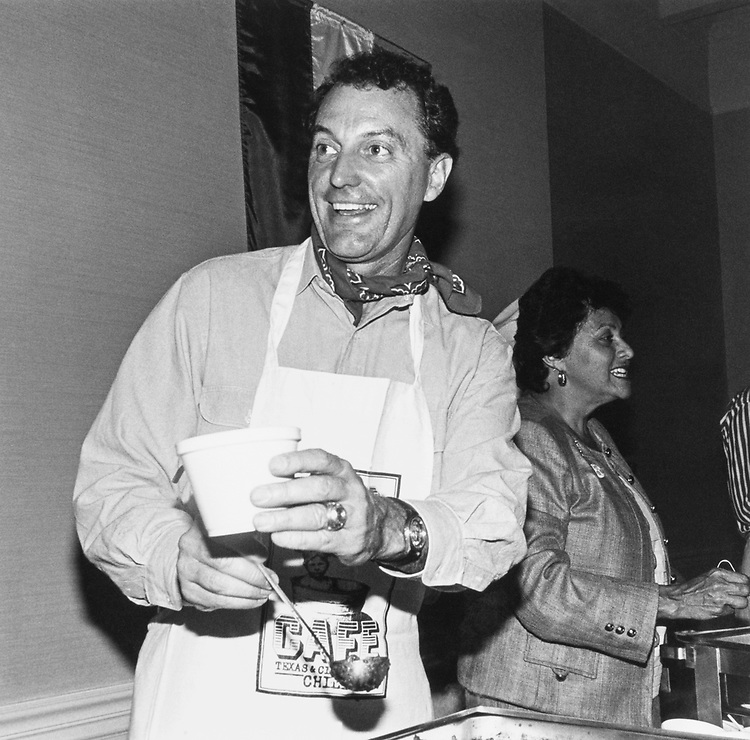 Rep. Ronald Machtley, R-R.I., who won the Chili Contest had 'Mild and hot' serving trays lowey in background on Sep. 16, 1991. (Photo by Laura Patterson/CQ Roll Call)