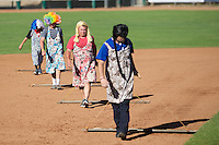 """The Ogden Raptors """"Drag Queens"""" attend to the field between innings as the Raptors played the Grand Junction Rockies on June 19, 2014 at Lindquist Field in Ogden, Utah. (Stephen Smith/Four Seam Images)"""