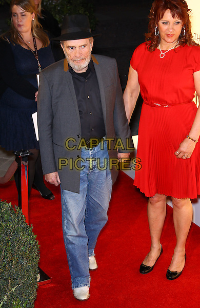 Merle Haggard, Theresa Ann Lane.Grand opening of The Smith Center for the Performing Arts, Las Vegas, Las Vegas, Nevada, USA, .10th March 2012..full length red dress jeans black shirt grey gray jacket hat .CAP/ADM/MJT.© MJT/AdMedia/Capital Pictures.