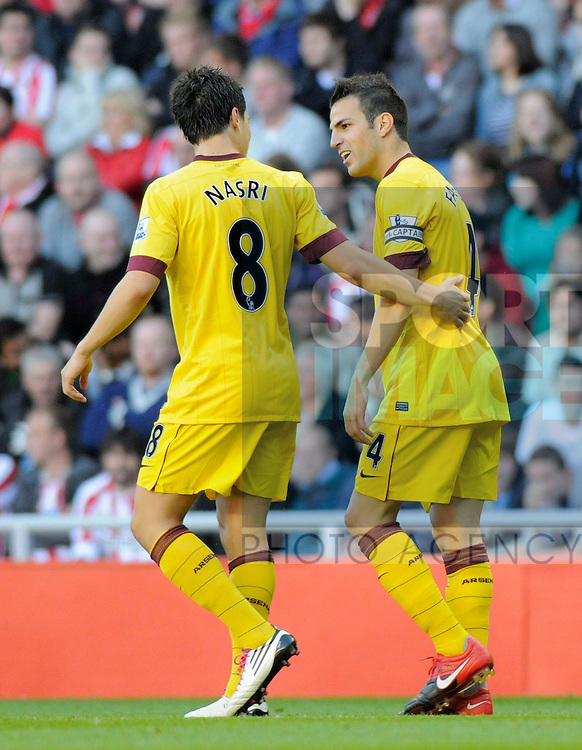 Arsenal's first goalscorer Cesc Fabregas celebrates with Samir Nasri.