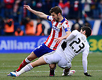 Real Madrid's midfielder Isco vies with Atletico Madrid's midfielder and captain Gabi during the Spanish league football match Club Atletico de Madrid vs Real Madrid CF at the Vicente Calderon stadium in Madrid on February 7, 2015.          PHOTOCALL3000/ DP