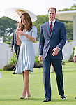 """CATHERINE, DUCHESS OF CAMBRIDGE AND PRINCE WILLIAM.visited the Kranji War Cemetery on their last day of their vsit to Singapore_13/09/2012.The Duchess used a parasol to protect her from the sun while she viewed the war graves..Mandatory credit photo: ©Dias/DIASIMAGES..(Failure to credit will incur a surcharge of 100% of reproduction fees)..                **ALL FEES PAYABLE TO: """"NEWSPIX INTERNATIONAL""""**..IMMEDIATE CONFIRMATION OF USAGE REQUIRED:.DiasImages, 31a Chinnery Hill, Bishop's Stortford, ENGLAND CM23 3PS.Tel:+441279 324672  ; Fax: +441279656877.Mobile:  07775681153.e-mail: info@newspixinternational.co.uk"""