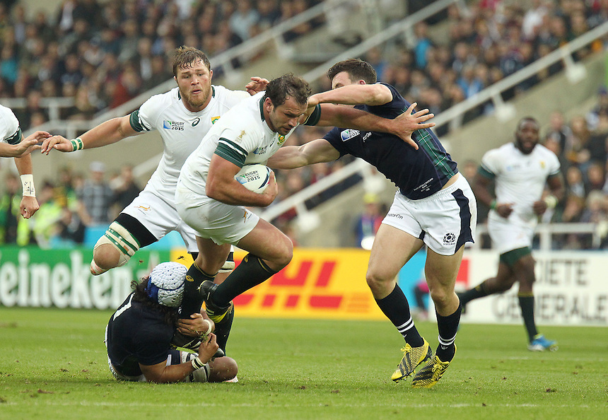South Africa's Bismarck du Plessis is tackled by Scotland's Blair Cowan<br /> <br /> Photographer Rich Linley/CameraSport<br /> <br /> Rugby Union - 2015 Rugby World Cup Pool B - South Africa v Scotland - Saturday 3rd October 2015 - St James's Park - Newcastle<br /> <br /> &copy; CameraSport - 43 Linden Ave. Countesthorpe. Leicester. England. LE8 5PG - Tel: +44 (0) 116 277 4147 - admin@camerasport.com - www.camerasport.com