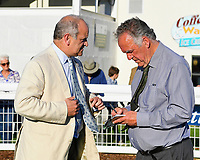 Trainer Brian Meehan talks to a member of the Press after winning The Saunton Sands Hotel North Devon Maiden Stakes with Amplify during Evening Racing at Salisbury Racecourse on 25th May 2019