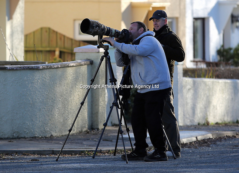 COPY BY TOM BEDFORD<br /> Pictured: Some of the birdwatchers observing the masked wagtail seen on house roofs in the village of Camrose, west Wales, UK. Wednesday 30 November 2016<br /> Re: Birdwatchers from all over Britain have turned up in a tiny Welsh village to see the first recorded visit of a masked wagtail.<br /> The species is normally found in Kazakhstan, Iran and Afghanistan but may have been brought here by the icy temperatures.<br /> It was spotted on the roof of a semi-detached house in Camrose, Pembrokeshire, yesterday(tues) but local birdwatchers were unable to identify it.<br /> An expert arrived and the bird was confirmed as the masked wagtail which has never been seen before in the British Isles.<br /> More than 40 twitchers drove through the night and slept in their cars to get the first glimpse of the bird seen flying between chimney pots in the village.<br /> Police were called because so many visitors turned up in the village, blocking country lanes and disturbing locals.<br /> But most locals welcomed the  birdwatchers, even making them cups of tea as they kept watch on the bird with binoculars and cameras.