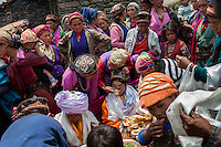 A wedding ceremony is held in Thuman, the one day ceremony involves offerings, tibetan tea, large amounts of food and local alcohol (Rakse). Thuman, Tamang Heritage Trail, Nepal, 06 May 2013.