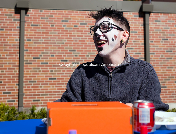 Winsted, CT- 10 October 2015-101015CM03- Eric Schindewolf, 17, shares a laugh with a friend during the 15th Annual Alumni Homecoming Family Day at The Gilbert School on Saturday.  The event was put on by the W.L. Gilbert Trust at the school on Saturday.  The event  featured children's activities, including a petting zoo, face painting, arts and crafts, games and an awards ceremony for distinguished alumni.       Christopher Massa Republican-American