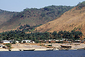 Tanzania. Village on the shore of Lake Tanganyika with dagar fish drying in the sun and fishing boats on the beach.