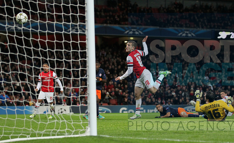 Arsenal's Jack Wilshere scoring his sides opening goal..Arsenal v Montpellier -Champions League- Emirates Stadium,London- 21/11/12 - Picture David Klein/Sportimage