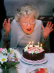 staff photo by Phil Grout<br /> <br /> Mrs. &quot;Howard&quot; W. Hubbard of Edenwald, Towson, rears back and gets<br /> ready to blow out her birthday candles during a celebration of her<br /> 86th birthday following dinner last Friday.   Before her retirement, <br /> &quot;Howard&quot; was employed by the Enoch-Pratt Library.
