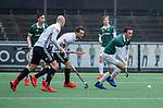 AMSTELVEEN - Diede van Puffelen (R'dam)  met Nicky Leijs (Adam)  tijdens de hoofdklasse competitiewedstrijd heren, AMSTERDAM-ROTTERDAM (2-2). COPYRIGHT KOEN SUYK