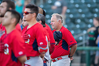 Springfield Cardinals manager Joe Kruzel (13) (right) and the team face the flag during the playing of the national anthem on May 16, 2019, at Arvest Ballpark in Springdale, Arkansas. (Jason Ivester/Four Seam Images)