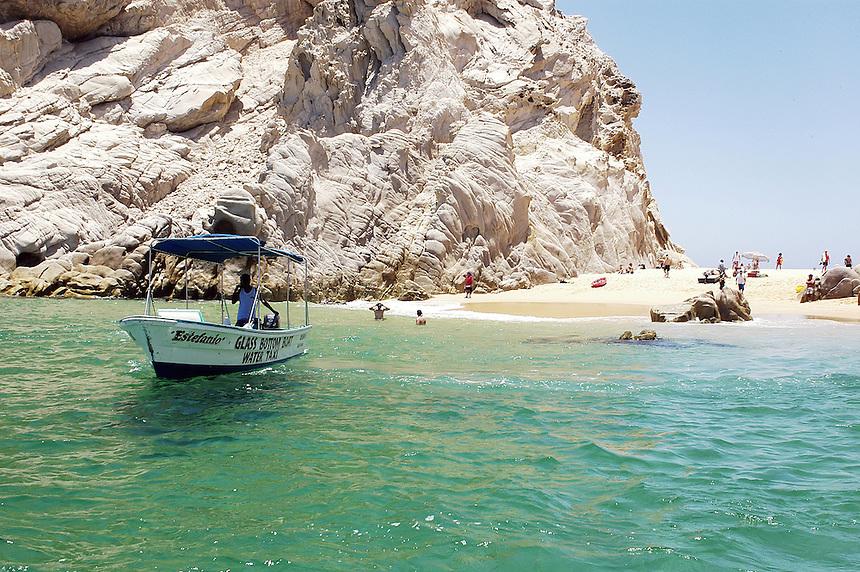Baja's most famous beach, Playa del Amor...  Esta franja de arena dorada entre impresionantes formaciones de rocas blancas une el Mar de Cortes con su vecino océano Pacifico.  Sólo se puede llegar en lancha, y es recomendable hacerlo por la mañana para evitar las aglomeraciones de turistas que la visitan durante la hora del almuerzo. Los Cabos, Baja California, Mexico