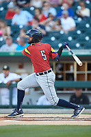 Willi Castro (5) of the Toledo Mud Hens follows through on his swing against the Charlotte Knights at BB&T BallPark on April 23, 2019 in Charlotte, North Carolina. The Knights defeated the Mud Hens 11-9 in 10 innings. (Brian Westerholt/Four Seam Images)