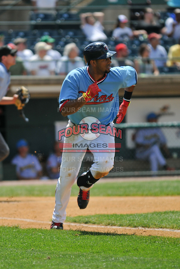 Aaron Hicks (32) of the New Britain Rock Cats runs to first base during a game against the Reading Fightin Phils at New Britain Stadium on June 22, 2014 in New Britain, Connecticut.   New Britain defeated Reading 5-3.  (Gregory Vasil/Four Seam Images)