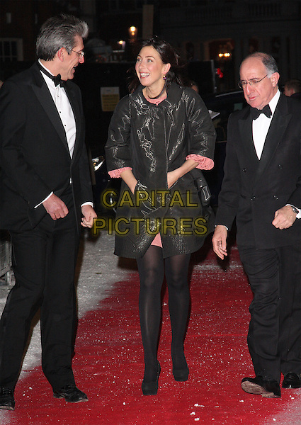 SAMANTHA CAMERON & GUESTS.The Dickensian Ball, Harrods, Hans Crescent, Knightsbridge, London, England..December 1st 2010.full length black tights coat hands in pockets platform shoes shiny Sam Samcam cam.CAP/ROS.©Steve Ross/Capital Pictures