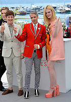 Alex Sharp, Elle Fanning &amp; John Cameron Mitchell at the photocall for &quot;How To Talk To Girls At Parties&quot; at the 70th Festival de Cannes, Cannes, France. 21 May 2017<br /> Picture: Paul Smith/Featureflash/SilverHub 0208 004 5359 sales@silverhubmedia.com