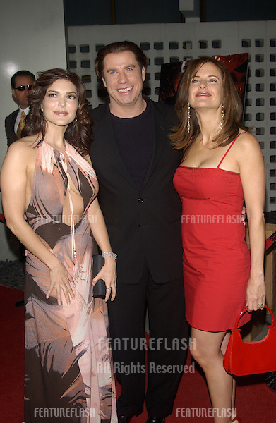 Actress LAURA HARRING (left) with actor JOHN TRAVOLTA & wife actress KELLY PRESTON at the Los Angeles premiere of their new movie The Punisher..April 12, 2004