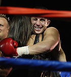 Joey Gilbert celebrates with his girl friend after his victory.  Photo by Tom Smedes.
