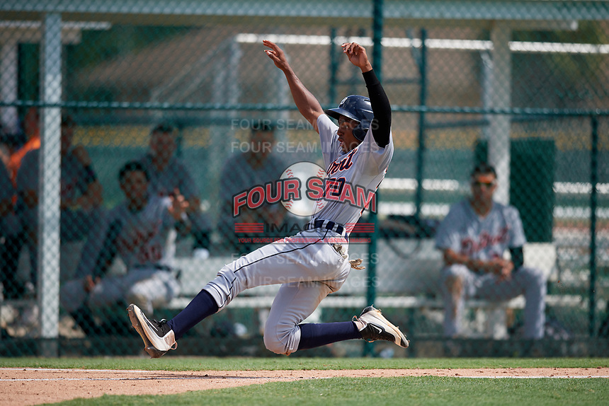 Detroit Tigers Isrrael De La Cruz (70) slides home during a Florida Instructional League game against the Pittsburgh Pirates on October 2, 2018 at the Pirate City in Bradenton, Florida.  (Mike Janes/Four Seam Images)