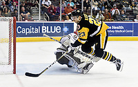 HERSHEY, PA - NOVEMBER 28: Wilkes-Barre/Scranton Penguins center Teddy Blueger (23) goes airborne after a poke check by Hershey Bears goalie Ilya Samsonov (1) during the third period of the Wilkes-Barre/Scranton Penguins at Hershey Bears on November 28, 2018 at the Giant Center in Hershey, PA. (Photo by Randy Litzinger/Icon Sportswire)