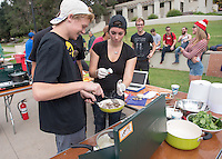Rhiannon Johnson '17 (black t-shirt), Trevor Brown '17 (SAE t-shirt) and Nick Foy '17 (black t-shirt). Occidental College students compete in the Iron Chef competition, sponsored by FEAST, in the AGC Quad on Oct. 31, 2014. Competitors were given ingredient options and a time limit to create a dish, which was judged by faculty and staff. (Photo by Marc Campos, Occidental College Photographer)