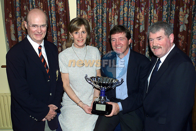 Neil Matthews Captain Co Louth Golf Club Left and Right Tom Ryan Vice-Captain Laytown & Bettystown Golf Club with Vicki and Des Smyth holding the Maderia Island open trophy at a function for Des in Laytown & Bettystown Golf Club..Pic Fran Caffrey Newsfile