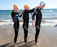 18 SEP 2010 - LA BAULE, FRA - Competitors help each other zip up their wetsuits before the start of the 2010 Mens French Club Championship Final (PHOTO (C) NIGEL FARROW)