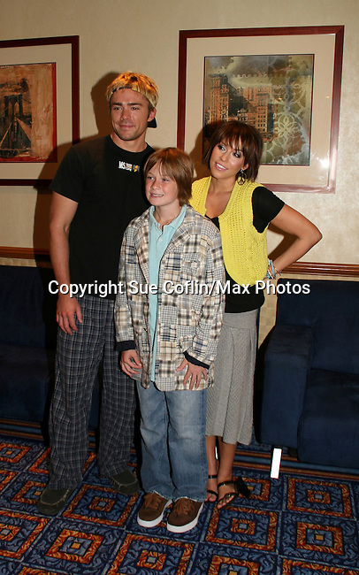 OLTL's Farah Fath poses with John-Paul Lavoisier and Austin Williams at the One Life To Live Fan Club Luncheon on August 16, 2008 at the New York Marriott Marquis, New York, New York.  (Photo by Sue Coflin/Max Photos)
