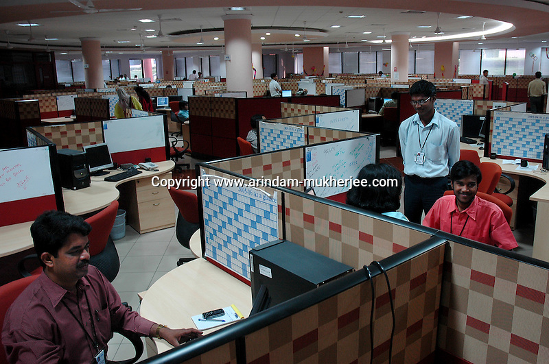 software company office. indian software professionals at work in infosys bangalore is the largest company office n