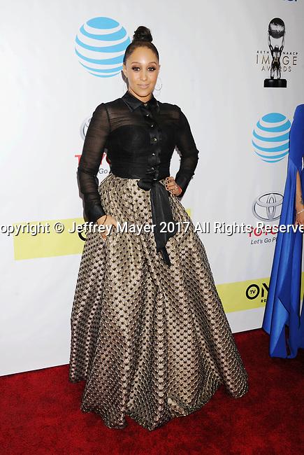 PASADENA, CA - FEBRUARY 11: Actress Tamera Mowry-Housely arrives at the 48th NAACP Image Awards at Pasadena Civic Auditorium on February 11, 2017 in Pasadena, California.