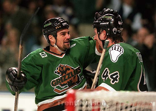 Utah's #22 Don Biggs is congratulated by #44 John Purves after his first period goal at Utah Grizzlies vs. Chicago Wolves<br />