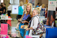NWA Democrat-Gazette/JASON IVESTER <br /> Kristy Bailey (left) and Becky Payne, both faculty members at Fulbright Junior High, peruse the Bentonville School District's Teacher Fair on Monday, Aug. 10, 2015, at Bentonville High School. The event, hosted by the Bentonville-Bella Vista Chamber of Commerce, featured 75 vendors for faculty and staff members throughout the school district.