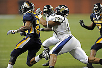 26 December 2010:  FIU linebacker Toronto Smith (13) runs down Toledo running back Adonis Thomas (24) in the fourth quarter as the FIU Golden Panthers defeated the University of Toledo Rockets, 34-32, to win the 2010 Little Caesars Pizza Bowl at Ford Field in Detroit, Michigan.