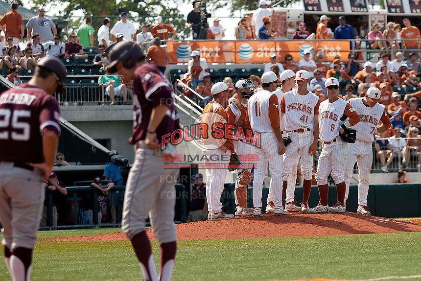Texas Longhorns pitching change during the NCAA baseball game against the Texas A&M Aggies on April 28, 2012 at UFCU Disch-Falk Field in Austin, Texas. The Aggies beat the Longhorns 12-4. (Andrew Woolley / Four Seam Images).