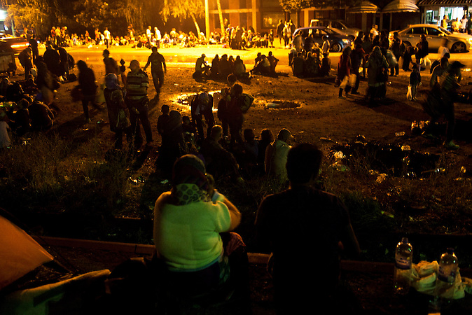 22.08.2015. Gevgelija, Macedonia  After the breach of the border and dramatic events that followed, the situation in Gevgelija was calming down, and as the night was approaching, everybody were trying to find a way to leave to Serbia, or safe place to spend the night in Gevgelija.