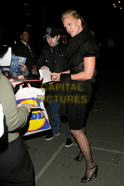 "NATASHA HENSTRIDGE.""Gone With The Wind"" press night party, Waldorf Hotel, Aldwych, London, England..April 22nd, 2008.full length black dress pattern tights collar fans signing autographs .CAP/AH.©Adam Houghton/Capital Pictures."
