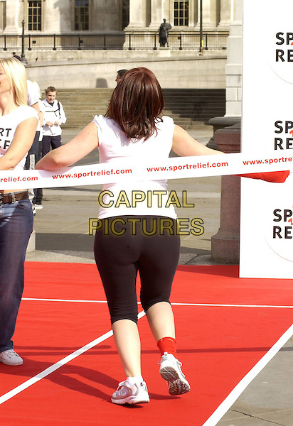 DAVINA McCALL.Launching Sport Relief in Trafalgar Square, London, UK. .May 3rd, 2006 .Ref: CAN.full length back behind rear tights black ribbon.www.capitalpictures.com.sales@capitalpictures.com.©Capital Pictures