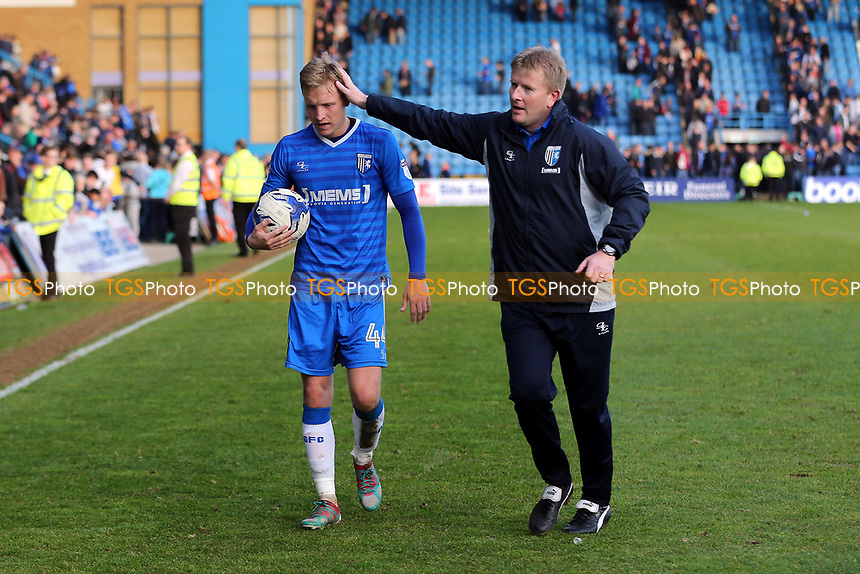 Gillingham Manager, Ady Pennock congratulates Josh Wright at the final whistle as he walks off the pitch with the match ball after scoring three penalties during Gillingham vs Scunthorpe United, Sky Bet EFL League 1 Football at the MEMS Priestfield Stadium on 11th March 2017