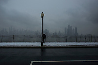 WEEHAWKEN NYJ- FEBRUARY 20: A man stands as the New York skyline is see on the background on February 20, 2019 from Weehawken New Jersey.  (Photo by Kena Betancur/VIEWpress/Corbis via Getty Images)