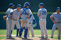 Lexington Legends manager Brooks Conrad (26) makes a pitching change as catcher Freddy Fermin (4), Rubendy Jaquez (2), Jeison Guzman (7), Matt Morales (1), and Reed Rohlman (21) look on during a South Atlantic League game against the Augusta GreenJackets on April 30, 2019 at SRP Park in Augusta, Georgia.  Augusta defeated Lexington 5-1.  (Mike Janes/Four Seam Images)