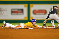 Mason Katz #5 of the LSU Tigers hangs on to second base after sliding past it against the Wake Forest Demon Deacons at Alex Box Stadium on February 18, 2011 in Baton Rouge, Louisiana.  The Tigers defeated the Demon Deacons 15-4.  Photo by Brian Westerholt / Four Seam Images