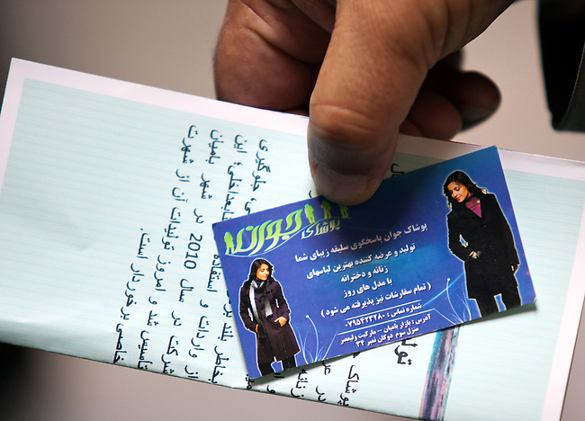 09 May 2012, Bamiyan, Afghanistan : A business card and brochure for Poshak Jawanan tailoring at Mullah Ghulam village on the outskirts of Bamiyan. It  is a small business venture looking to grow and expand both its workforce and output. It is benefiting from the Afghan Rural Enterprise Development Program (REDP). It has been in the program for three months and is hoping to find larger space to get more workers but is hamstrung by the lack of city power to drive its machinery. .The World Bank is funding the REDP in conjunction with the Afghan Government by providing assistance with training for employees, marketing for the products and arranging access to finance to expand and grow the small business venture . Picture by Graham Crouch/World Bank