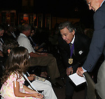 28 August 2006: 2006 inductee Philip Anschutz (center) with his presenter Chris Henderson (r) and Henderson's two children (seated, left). The National Soccer Hall of Fame Induction Ceremony was held at the National Soccer Hall of Fame in Oneonta, New York.