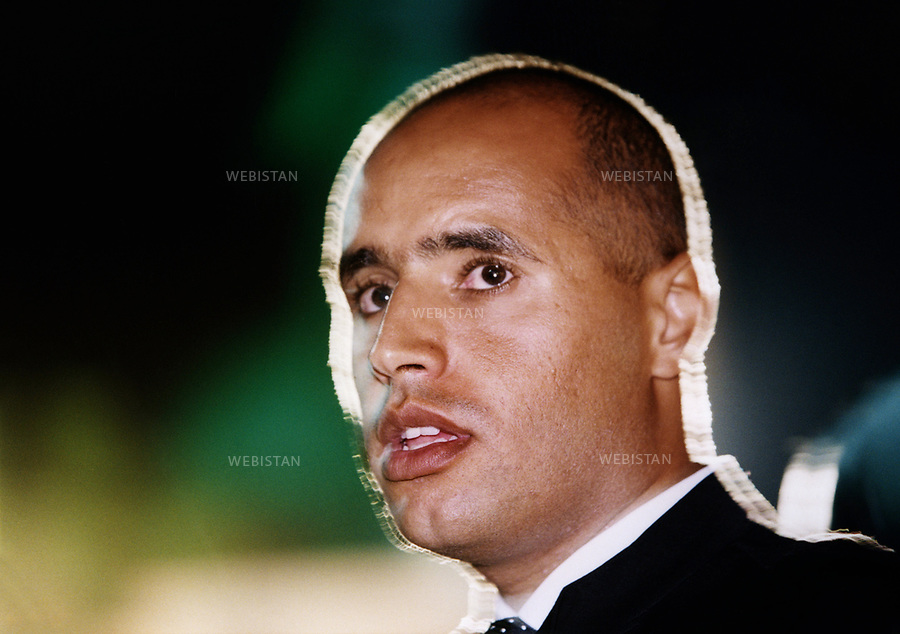 Libya. Tripoli. April 2000. Portrait of the son of Colonel Kadhafi, Saif al Islam. He is the main diplomatic counsellor of his father in international affairs. Libye. Tripoli. avril 2000. portrait du fils du colonel Kadhafi, Saif Al Islam. Il est le principal conseiller diplomatique de son père pour les affaires internationales.