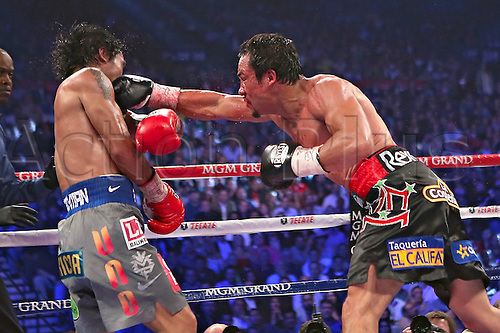 09.12.2012. Las Vegas, Nevada, USA. World Championship Welterweight Title fight.  Juan Manuel Marquez of Mexico Hits Manny Pacquiao of The Philippines during their Welterweight Fight in Las Vegas. Marquez defeated  Pacquiao by a knock-out during The Sixth Round