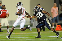 27 November 2010:  FIU linebacker Chris Edwards (60) tackles Arkansas State wide receiver Allen Muse (17) in the third quarter as the FIU Golden Panthers defeated the Arkansas State Red Wolves, 31-24, at FIU Stadium in Miami, Florida.
